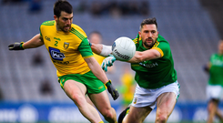 Donegal's Paddy McGrath attempts to get away from Meath's Mickey Newman during the Allianz NFL Division 2 final. Photo by Ray McManus/Sportsfile