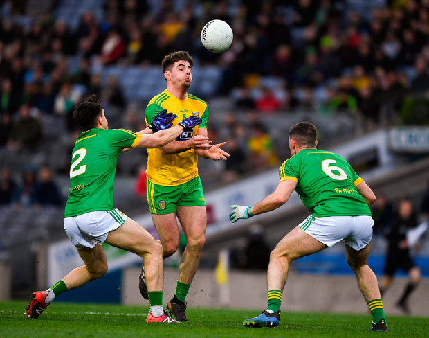 Daire O'Donnell of Donegal in action against Séamus Lavin, left, and Donal Keogan of Meath. Photo by Ray McManus/Sportsfile