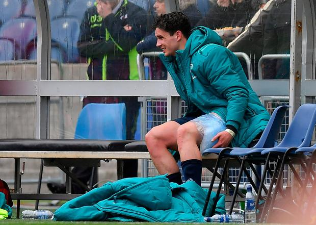 Joey Carbery sits on the bench with an ice pack on his leg following his substitution during Saturday's Champions Cup win in Edinburgh. Photo: Brendan Moran/Sportsfile