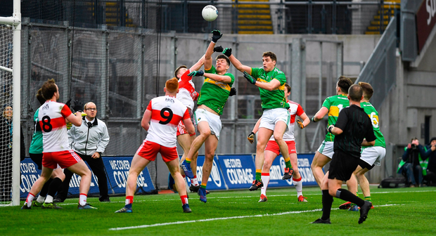 Leitrim pair Pearce Dolan and Raymond Mulvey contest a dropping ball with Paul McNeill of Derry in the final minutes of their Division 4 final. Photo by Ray McManus/Sportsfile