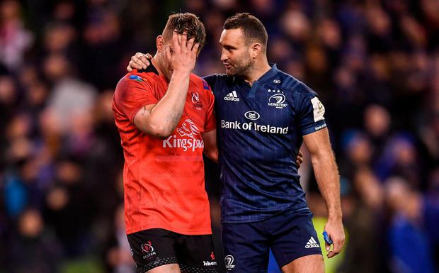 Best of enemies: Dave Kearney consoles his former team-mate Jordi Murphy after Leinster's victory. Photo: Stephen McCarthy/Sportsfile