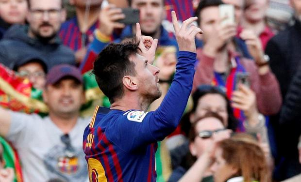Lionel Messi celebrates scoring his first goal for Barcelona in their win over Espanyol. Photo: REUTERS/Albert Gea