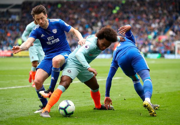 Chelsea's Willian (centre) and Cardiff City's Harry Arter battle for the ball. Photo: Nick Potts/PA Wire