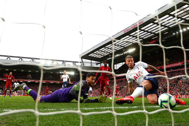 Own goal: Hugo Lloris can only look on as Toby Alderweireld gets the last touch for Liverpool's winner. Photo by Clive Brunskill/Getty Images