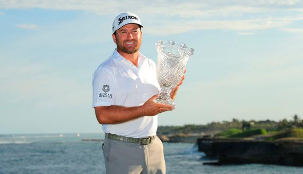 Graeme McDowell shows off the trophy after winning the Corales Puntacana Resort & Club Championship, his first Tour victory in over three years. Photo: Mike Ehrmann/Getty Images