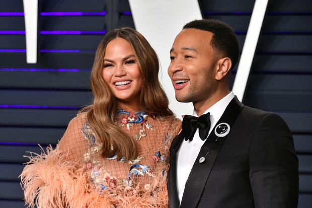 Chrissy Teigen (L) and John Legend attend the 2019 Vanity Fair Oscar Party hosted by Radhika Jones at Wallis Annenberg Center for the Performing Arts on February 24, 2019 in Beverly Hills, California. (Photo by Dia Dipasupil/Getty Images)