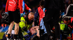 Dan Leavy of Leinster receives medical attention against Ulster