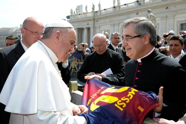 Pope Francis receives a Barcelona soccer jersey of player Lionel Messi