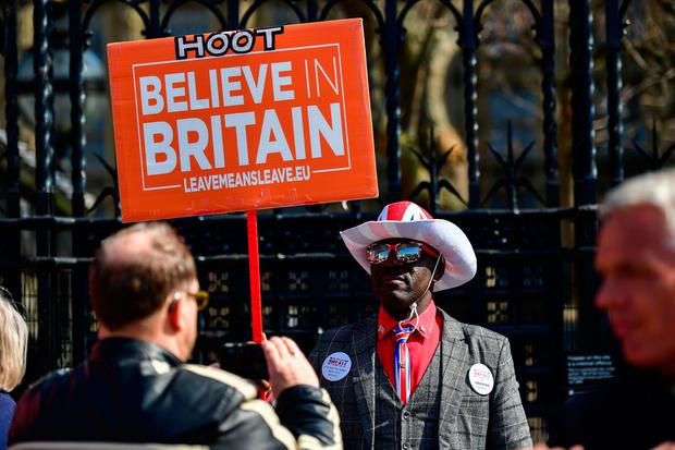 Joesph Afrane shows his support for Brexit wearing a Union Jack hat and Union Jack shoes outside the Houses of Parliament, Westminster, London, ahead of the latest round of debates in the House of Commons concerning Brexit issues. Rebecca Brown/PA Wire