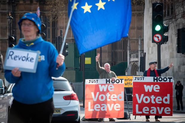 Leave and remain protesters outside the Houses of Parliament, London, ahead of the latest round of debates in the House of Commons concerning Brexit issues. Stefan Rousseau/PA Wire