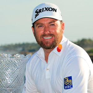 Graeme McDowell poses with the trophy after putting in to win on the 18th green during the final round of the Corales Puntacana Resort & Club Championship in Punta Cana, Dominican Republic