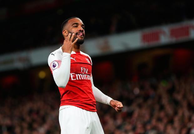 Alexandre Lacazette of Arsenal celebrates after scoring his team's second goal. Photo: Catherine Ivill/Getty Images