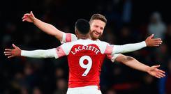 Shkodran Mustafi and Alexandre Lacazette of Arsenal (9) celebrate victory. Photo: Catherine Ivill/Getty Images