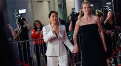 Canadian actress Sandra Oh (L) and British actress Jodie Comer (R) arrive for BBC America and AMC's