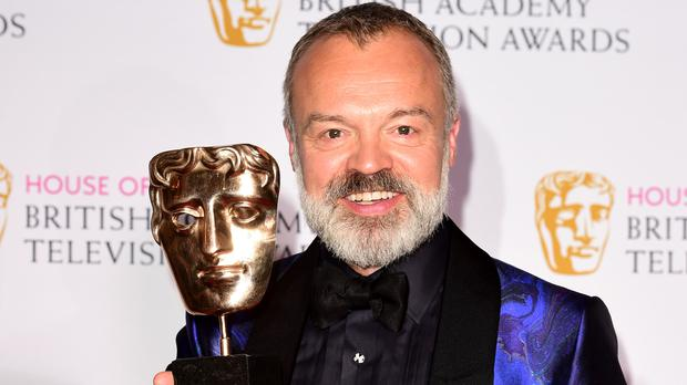 Graham Norton is returning to host this year's Bafta Television Awards (Ian West/PA)