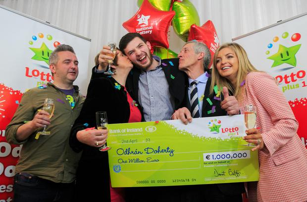 Odhrán Doherty (23) from Raphoe in Co Donegal (centre) with family (L to R) Shane Doherty, Margaret Doherty, Liam Doherty, Lana Doherty after collecting his cheque. Photo: Gareth Chaney Collins