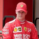 Mick Schumacher walks in the pit during his first F1 test for Ferrari at the Bahrain International Circuit in Sakhir, Bahrain, Tuesday, April 2, 2019. (AP Photo/Hassan Ammar)