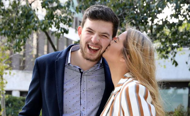 Winning smile: Donegal farmer Odhrán Doherty (23) with his girlfriend Jessica Orr at the Lottery HQ after collecting his winnings. Photo: Mac Innes Photography