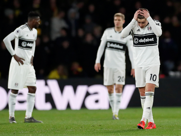 Fulham's Tom Cairney and his team-mates show their dejection. Photo: Reuters