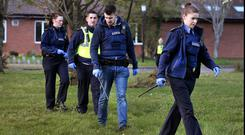Combing area: Gardaí search Riversdale Community College in following the shooting. Photo: Steve Humphreys