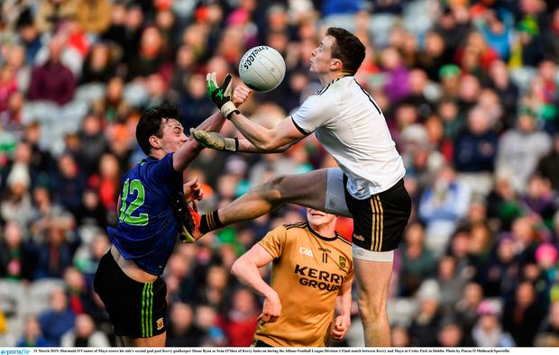 Diarmuid O'Connor of Mayo scores his side's second goal past Kerry goalkeeper Shane Ryan as Seán O'Shea of Kerry looks on during the Allianz Football League Division 1 Final match between Kerry and Mayo at Croke Park in Dublin. Photo by Piaras Ó Mídheach/Sportsfile