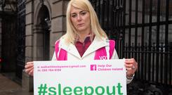Waiting: Lesley Anne O'Brien outside the Dáil yesterday before her sleep-out. Photo: Owen Breslin