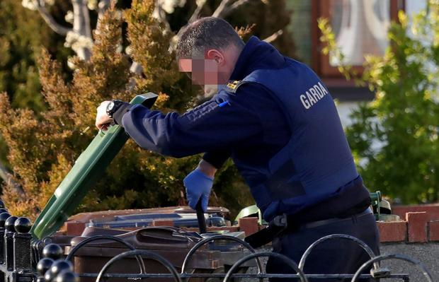 Hunt: A garda searches near the scene of the shooting in Dublin on Tuesday