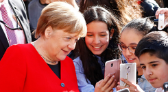Visit: German Chancellor Angela Merkel with pupils at the Thomas-Mann High School as part of the Europe-Project Day in Berlin, Germany, this week. Photo: Reuters
