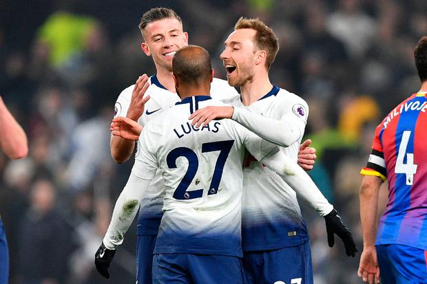Spurs' midfielder Christian Eriksen (R), Lucas Moura (C) and Toby Alderweireld (L) celebrate on the pitch. Photo: AFP/Getty Images