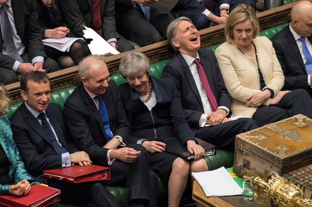 All smiles: British Prime Minister Theresa May and her front bench enjoy a lighter moment during Prime Minister's Questions in the House of Commons yesterday. Photo: UK Parliament/Mark Duffy/PA Wire