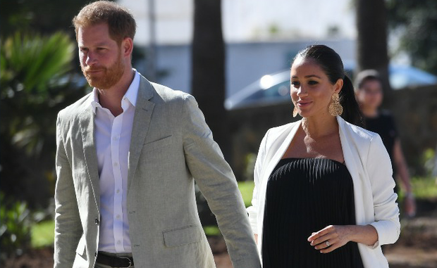 Britain's Prince Harry and Meghan walk through the walled public Andalusian Gardens which has exotic plants, flowers and fruit trees during a visit on February 25, 2019 in Rabat, Morocco. (Photo by Facundo Arrizabalaga - Pool/Getty Images)