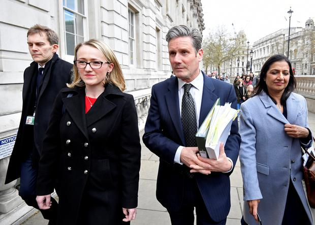 Britain's Labour Party's Shadow Secretary of State for Departing the European Union Keir Starmer and Labour Party's Shadow Business Secretary Rebecca Long-Bailey leave the Cabinet Office, as Brexit wrangles continue, in London