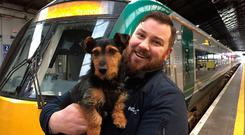 Day out: Rail worker Ted Maher with Tyson. PHOTO: PA
