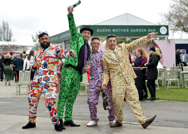 Horse Racing - Grand National Festival - Aintree Racecourse, Liverpool, Britain - April 5, 2019 Racegoers pose during the Grand National Festival REUTERS/Peter Powell