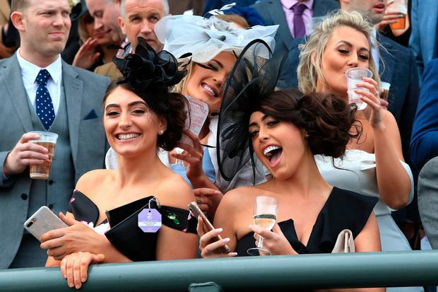 Racegoers during Ladies Day of the 2019 Randox Health Grand National Festival at Aintree Racecourse. Peter Byrne/PA Wire