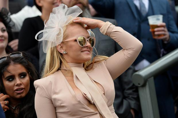 Horse Racing - Grand National Festival - Aintree Racecourse, Liverpool, Britain - April 5, 2019 A racegoer on ladies day during the 2.50 Betway Mildmay Novices' Chase REUTERS/Peter Powell