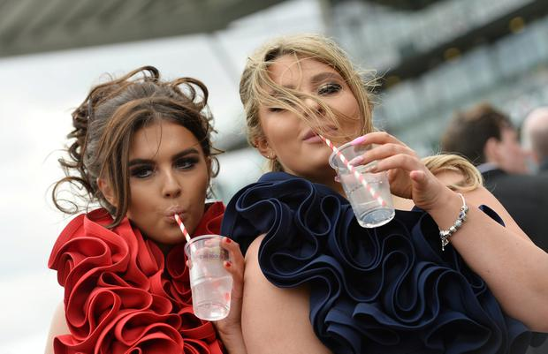Horse Racing - Grand National Festival - Aintree Racecourse, Liverpool, Britain - April 5, 2019 Racegoers pose on ladies day after the 2.50 Betway Mildmay Novices' Chase REUTERS/Peter Powell