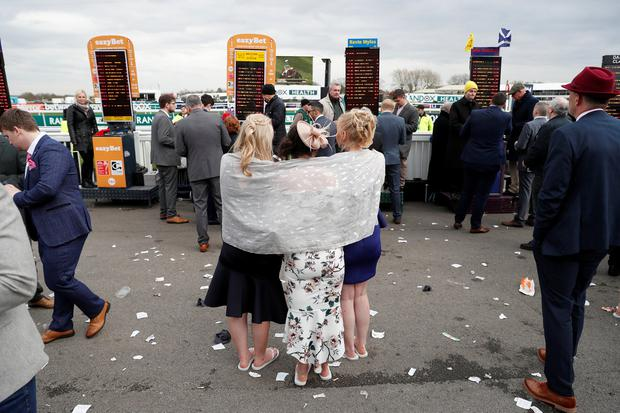 Horse Racing - Grand National Festival - Aintree Racecourse, Liverpool, Britain - April 5, 2019 Racegoers during the 4.40 Doom Bar Sefton Novices' Hurdle Action Images via Reuters/Paul Childs