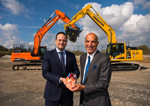 Good news: Taoiseach Leo Varadkar and Edwards Lifesciences CEO Mike Mussallem with a model heart at the site of the plant. Photo: Diarmuid Greene