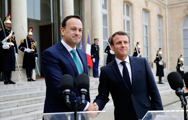 French President Emmanuel Macron, right, shakes hands with Taoiseach Leo Varadkar after a media conference at the Elysee Palace. Photo: AP