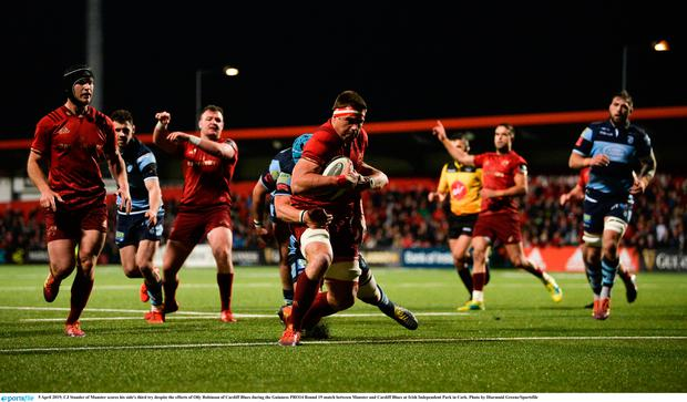 CJ Stander of Munster scores his side's third try despite the efforts of Olly Robinson of Cardiff Blues during the Guinness PRO14 Round 19 match between Munster and Cardiff Blues at Irish Independent Park in Cork. Photo by Diarmuid Greene/Sportsfile