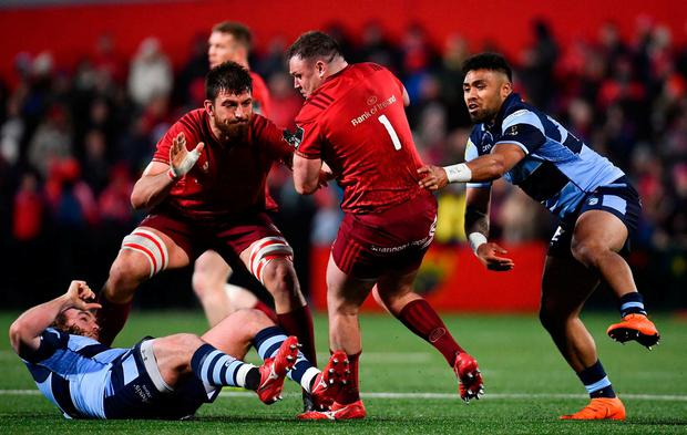 Dave Kilcoyne of Munster is tackled by Rey Lee-Lo of Cardiff Blues. Photo: Ramsey Cardy/Sportsfile
