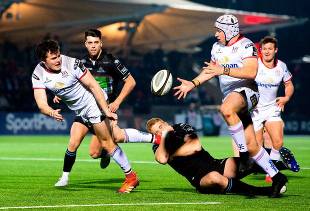 Jacob Stockdale of Ulster, left, is tackled by Kyle Steyn of Glasgow Warriors. Photo: Ross Parker/Sportsfile
