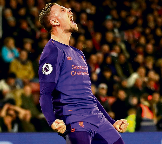 Substitute Jordan Henderson celebrates after scoring Liverpool's third goal to seal victory at St Mary's. Photo: AP