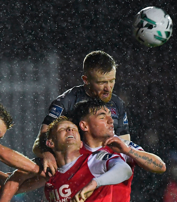 Dundalk's Seán Hoare rises above St Patrick's Athletic's Gary Shaw and Kevin Toner. Photo: Sportsfile