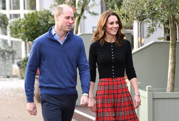 Prince William, Duke of Cambridge and Catherine, Duchess of Cambridge at an event at Kensington Palace