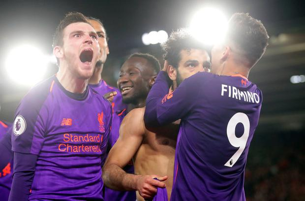 Liverpool's Mohamed Salah (second right) celebrates scoring his side's second goal of the game with team-mates during the Premier League match at St Mary's Stadium, Southampton.