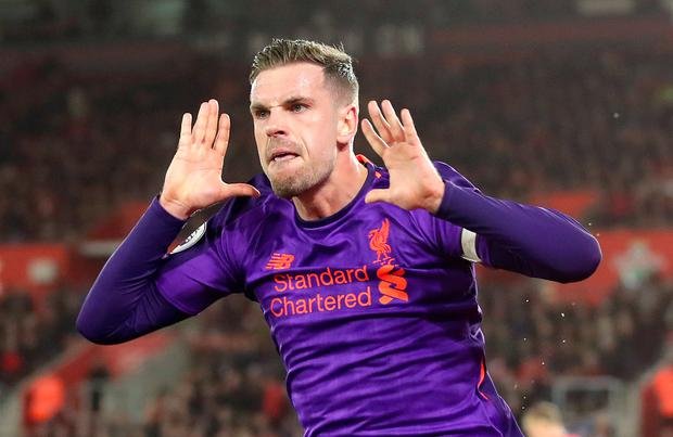 Liverpool's Jordan Henderson celebrates scoring his side's third goal of the game during the Premier League match at St Mary's Stadium, Southampton.