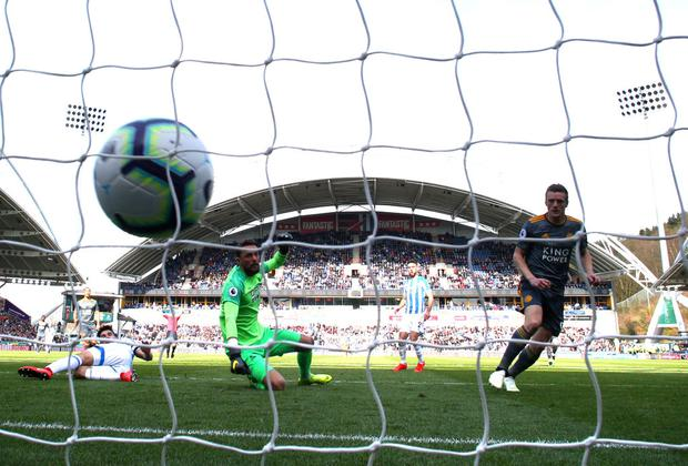 Jamie Vardy of Leicester City scores his team's second goal past Ben Hamer of Huddersfield Town (Photo by Matthew Lewis/Getty Images)