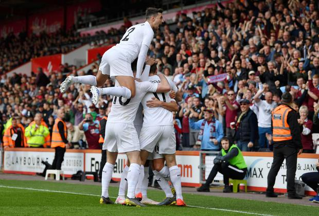 Chris Wood of Burnley celebrates after scoring his team's first goal with his team mates during the Premier League match between AFC Bournemouth and Burnley FC at the Vitality Stadium (Photo by Justin Setterfield/Getty Images)